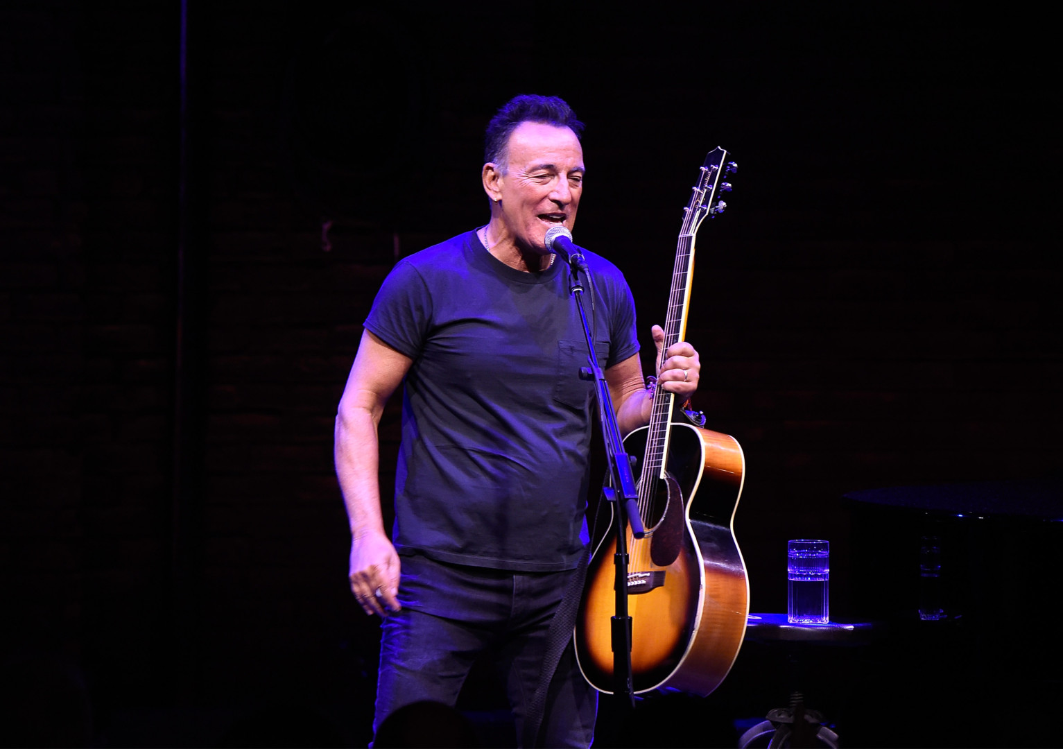 "NEW YORK, NY - OCTOBER 12:  Bruce Springsteen performs onstage during ""Springsteen On Broadway"" at Walter Kerr Theatre on October 12, 2017 in New York City.  (Photo by Kevin Mazur/Getty Images)"