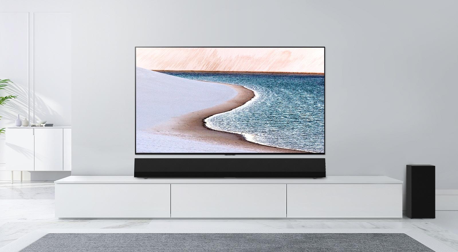 LG GX Soundbar er kledd i mørkegrått stofftrekk. Den kan henges på vegg eller stå på bordet. (Foto: LG)
